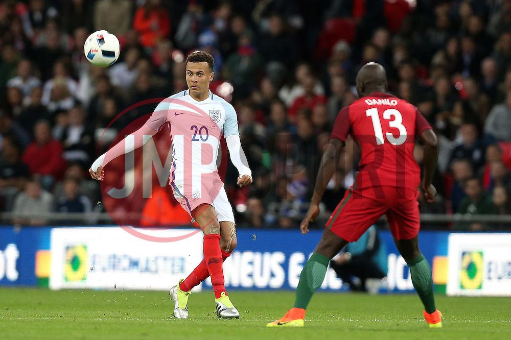 Dele Alli of England plays a long pass past Danilo - Mandatory by-line: Robbie Stephenson/JMP - 02/06/2016 - FOOTBALL - Wembley Stadium - London, United Kingdom - England v Portugal - International Friendly