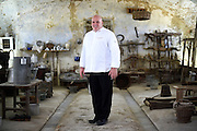 Tim Wasylko, Chef to the Prime Minister of Canada, poses for a portrait in the Cascina Colombara during the annual meeting of the Club des Chefs des Chefs in Livorno Ferraris, Vercelli, Italy, July 18, 2015.<br /> The Club des Chefs des Chefs, which is seen as the world's most exclusive gastronomic society, has extremely strict membership criteria: to be accepted into this highly elite club, you need to be the current personal chef of a head of state. If he or she does not have a personal chef, members can be the executive chef of the venue that hosts official State receptions. One of the society's primary purposes is to promote major culinary traditions and to protect the origins of each national cuisine. The Club des Chefs des Chefs also aims to develop friendship and cooperation between its members, who have similar responsibilities in their respective countries. <br /> The annual meeting of the Club has been hosted this year in the production site of the Italian rice company called Riso Acquerello. <br /> © Giorgio Perottino