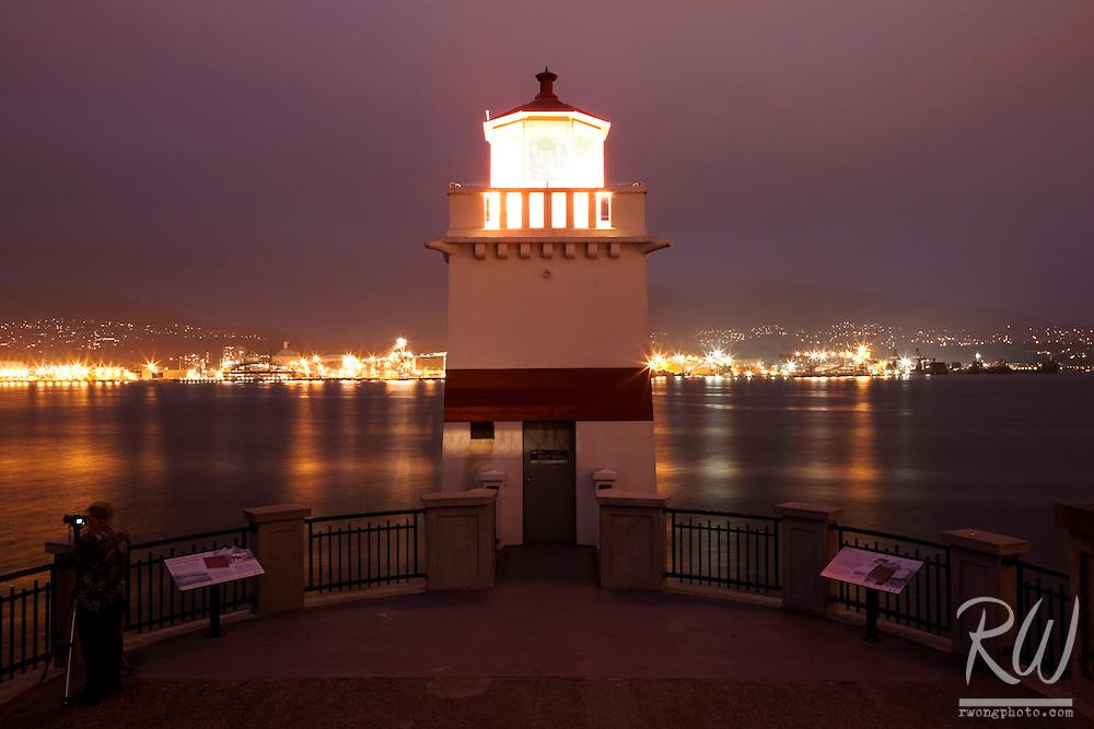Photographer at Stanley Park's Brockton Point Lighthouse, Vancouver, B.C.