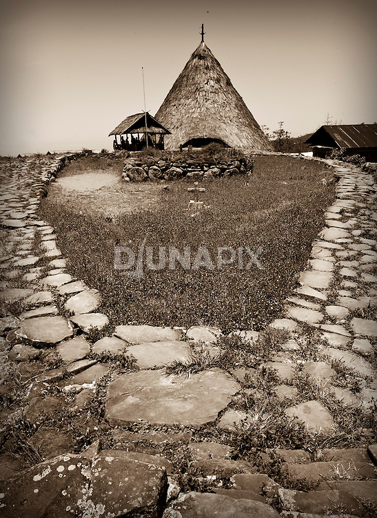 Sepia-toned rendition of a traditional home, Todo village, Manggarai, Flores