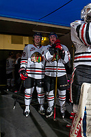 KELOWNA, CANADA - OCTOBER 21: Reece Newkirk #38 and Clay Hanus #58 of the Portland Winterhawks stand in the tunnel at the start of second period against the Kelowna Rockets on October 21, 2017 at Prospera Place in Kelowna, British Columbia, Canada.  (Photo by Marissa Baecker/Shoot the Breeze)  *** Local Caption ***