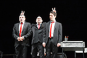14/02/2013. London, UK. Eugène Ionesco's Rhinocéros is one of the major Absurdist plays of the 20th century. As compelling as ever, it warns against totalitarianism and the destructive power of the collective. Théâtre de la Ville's production has wowed critics and audiences across France and the USA with its spectacular set and gripping performances. Picture shows: Serge Maggiani, Pascal Vuillemont & Jauris Casanova.