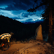 Rex Flake riding single track after dark in Leavenworth, Washington.