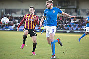 Macclesfield Town defender Fiacre Kelleher challenged by the opponent during the EFL Sky Bet League 2 match between Macclesfield Town and Bradford City at Moss Rose, Macclesfield, United Kingdom on 30 November 2019.
