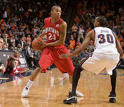 Maryland guard/forward Cliff Tucker (24) is guarded by Virginia forward Adrian Joseph (30).  The Virginia Cavaliers defeated the Maryland Terrapins 91-76 at the University of Virginia's John Paul Jones Arena  in Charlottesville, VA on March 9, 2008.