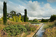A rill and water feature surrounded by late summer borders in the walled garden, Broughton Grange, Banbury, Oxfordshire, UK