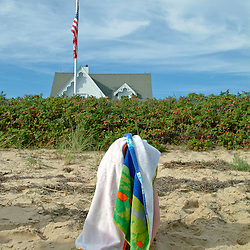 Child hiding from camera under beach towel. Provincetown, Massachusetts