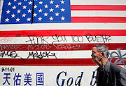 US-SAN FRANCISCO: Protest against president George Bush on a mural of the American Flag in Chinatown. PHOTO:  GERRIT DE HEUS