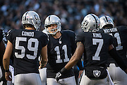 Teammates celebrate with Oakland Raiders kicker Sebastian Janikowski (11) after scoring a go-ahead field goal against the Carolina Panthers in the fourth quarter at Oakland Coliseum in Oakland, Calif., on November 27, 2016. (Stan Olszewski/Special to S.F. Examiner)