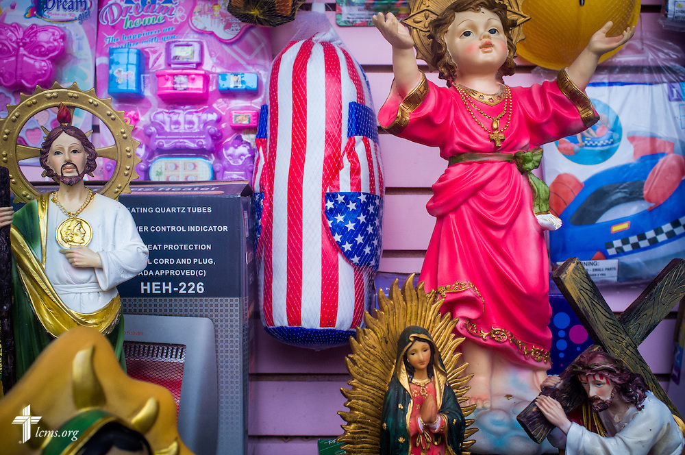 In a downtown variety store window, plastic statues line the shelf Sunday, April 17, 2016,  in Brownsville, Texas. Roman Catholic influences run deep in the Hispanic community. LCMS Communications/Erik M. Lunsford