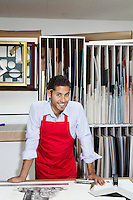 Portrait of a happy skilled worker in workshop
