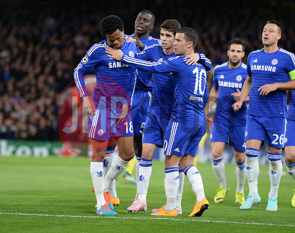 Chelsea's Loic Remy looks in pain just after he scores Chelsea's Oscar and Chelsea's Eden Hazard check to see if he is okay.  - Photo mandatory by-line: Alex James/JMP - Mobile: 07966 386802 - 21/10/2014 - SPORT - Football - London - Stamford Bridge - Chelsea v NK Maribor - Champions League