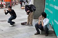 Europe, Germany, Cologne, Japanese tourists try to photograph the Cologne cathedral...Europa, Deutschland, Koeln, japanische Touristen versuchen den Koelner Dom zu fotografieren.