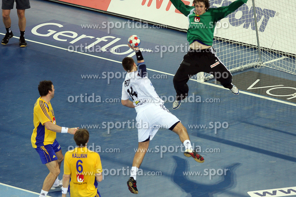Andrej Petro (14) of Slovakia vs Goalekeeper of Sweden Per Sandstrom during 21st Men's World Handball Championship 2009 Main round Group I match between National teams of Sweden and Slovakia, on January 27, 2009, in Arena Zagreb, Zagreb, Croatia.  (Photo by Vid Ponikvar / Sportida)