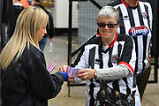 Grimsby Town fan buys a tickets for the half time raffle during the EFL Sky Bet League 2 match between Grimsby Town FC and Oldham Athletic at Blundell Park, Grimsby, United Kingdom on 15 September 2018.