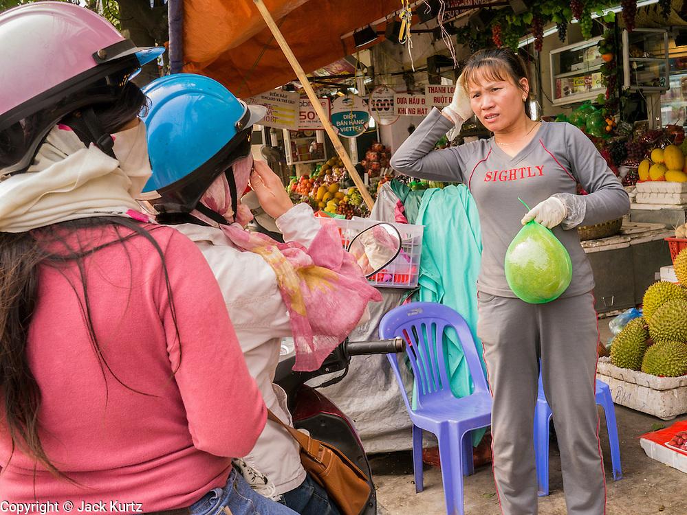 02 APRIL 2012 - HANOI, VIETNAM: A market vendor sells durian in Hanoi, the capital of Vietnam.    PHOTO BY JACK KURTZ