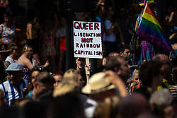 "© Licensed to London News Pictures . 05/08/2018. Leeds, UK. Anti capitalist "" Queer liberation not rainbow capitalism "" placard . Leeds Gay Pride parade through the Yorkshire city's centre . Leeds's annual Gay Pride festiva celebrates the city's LGBTQ+ life and culture . Photo credit: Joel Goodman/LNP"