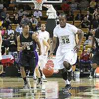 Central Florida guard/forward Isaiah Sykes (32) during a fast break in the first half against the Furman Paladins at the UCF Holiday Classic at the UCF Arena on December 29, 2010 in Orlando, Florida. (AP Photo/Alex Menendez)