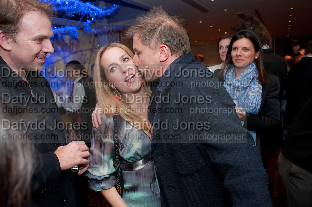 GILLIAN ANDERSON; SIMON MCBURNEY, The after-party after the premiere of Duncan WardÕs  film ÔBoogie WoogieÕ ( based on the book by Danny Moynihan). Westbury Hotel. Conduit St. London.  13 April 2010<br /> GILLIAN ANDERSON; SIMON MCBURNEY, The after-party after the premiere of Duncan Ward's  film 'Boogie Woogie' ( based on the book by Danny Moynihan). Westbury Hotel. Conduit St. London.  13 April 2010