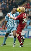 Photo: Ed Godden.<br />Coventry City v Brighton & Hove Albion. Coca Cola Championship. 04/02/2006. <br />Coventry's Dele Adebola (L) and Paul McShane clash for the ball.