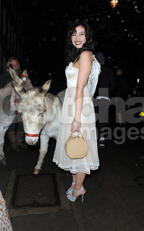 Daisy Lowe wearing her wings arrives at the Love Magazine Christmas party in London. UK. 17/12/2013<br />