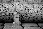 "Colleville sur Mer | Oct 15 2009..A little wooden cross wich reads ""To the men of the 1st US Infantry Division - We will never forget you - Your british friends - In rememberance"" is seen at a memorial made of a stone pillar to commemorate the 1st US Army Infantry Division (Big Red One) is seen on Omaha Beach, situated below the french village of Colleville sur Mer. Colleville sur Mer was one of the first villages to be freed by Allied Forces entering Europe on June 6, 1944 (D-Day)...Photo: juelich/ip-photo.com"