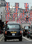 © Licensed to London News Pictures. 30/05/2012. London, UK A view down Regents Street showing a black hackney cab  and Union Flag bunting across the street. Preparations today 20th May 2012 around London ahead of The Queen's Diamond Jubilee this weekend. Photo credit : Stephen Simpson/LNP
