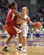 Kansas State forward Danielle Zanotti (25) looks to make a pass against pressure from Oklahoma's Courtney Paris (3), during the second half at Bramlage Coliseum in Manhattan, Kansas, February 21, 2006.  The 9th ranked Sooners defeated K-State 78-64.