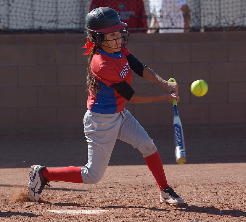gbs040417m/SPORTS -- West Mesa's Desiree Gurule hits a double in the first inning of the game against Atrisco Heritage at West Mesa on Tuesday, April 4, 2017. (Greg Sorber/Albuquerque Journal)