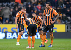 Hull City's Tom Huddlestone and his team-mates look dejected - Photo mandatory by-line: Richard Martin-Roberts/JMP - Mobile: 07966 386802 - 31/01/2015 - SPORT - Football - Hull - KC Stadium - Hull City v Newcastle United - Barclays Premier League