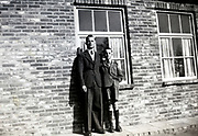 young adult man and boy posing early 1950s Netherlands