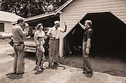 A local newspaperman photographs Governor Carter as he campaigns door-to-door in the rural South.