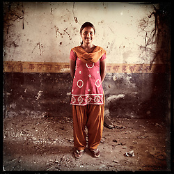 "iPhone portrait of Rajyanti Bairwa, 17, in a village outside of Tonk, Rajasthan, India, April 3, 2013. ""I came to school and told the girls 'I am about to get married' and asked the girls go to my parents and tell them not to let the marriage happen. With their help, I refused the marriage because I want to study and be something. In life I want to be a doctor,"" said Bairwa.<br /> <br /> Under Indian law, children younger than 18 cannot marry. Yet in a number of India's states, at least half of all girls are married before they turn 18, according to statistics gathered in 2012 by the United Nations Population Fund (UNFPA). However, young girls in the Indian state of Rajasthan—and even a few boys—are getting some help in combatting child marriage. In villages throughout Tonk, Jaipur and Banswara districts, the Center for Unfolding Learning Potential, or CULP, uses its Pehchan Project to reach out to girls, generally between the ages of 9 and 14, who either left school early or never went at all. The education and confidence-building CULP offers have empowered young people to refuse forced marriages in favor of continuing their studies, and the nongovernmental organization has provided them with resources and advocates in their fight."
