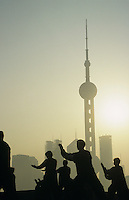 China Shanghai silhouettes of people against city skyline (Oriental Pearl TV Tower)