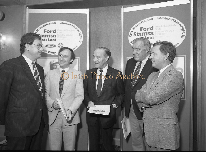 "Ford Siamsa Cois Laoi..1985..17.06.1985..06.17.1985..17th June 1985..At a press luncheon in Dublin, the names of the forthcoming artists for the Siamsa Cois Laoi music festival were announced. The artists include, Kris Kristofferson,Louden Wainwright III,.Stocktons Wing and The Wolfe Tones..The Ford sponsored festival takes place in Parc Ui Chaoimh,Cork City,on the 28th of July.This is the second year of a three year sponsorship deal.It is hoped that after the success of last years'event that this year will be bigger and better than ever..Mr Kieven,Chairman and M.D. of Ford Ireland stated ""The 1984 Ford Siamsa was Ford's first association with Ireland's Premier Folk Music Festival..Ford were very pleased with the outstanding success that was achieved and that the friendly co-operation of everyone involved helped to ensure a memorable day""...Pictured at the announcement of the feature artists were,.Mr Hartmut Kieven,Chairman and Managing Director,Ford Ireland,Mr Frank Murphy,Secretary,Cork County Board,Mr Con Murphy, Chairman,Cork County Board,Mr Donal O'Sullivan,Chairman,Parc Ui Chaoimh,Grounds Committee and Mr Oliver Barry the event promoter...Parc Ui Chaoimh is the GAA home of Cork Football and Hurling........."