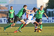 Bristol Rovers Bernard Mensah (23) charing past the Scunthorpe midfield Manager Graham Alexander during the EFL Sky Bet League 1 match between Bristol Rovers and Scunthorpe United at the Memorial Stadium, Bristol, England on 24 February 2018. Picture by Gary Learmonth.