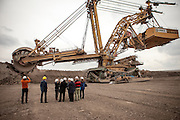 Visitors in front of a brown coal excavator at the North Bohemian brown coal Basin in Most, Czech Republic. The Czech Coal Group offers visitors the possibilty to see unique technical works in the mining areas of their surface mines.