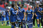 AFC Wimbledon defender Jon Meades (12) celebrating promotion at the end of the Sky Bet League 2 play off final match between AFC Wimbledon and Plymouth Argyle at Wembley Stadium, London, England on 30 May 2016.