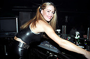 A smiling female DJ at her decks, Roar, Evolution, Cardiff, Wales, 2001