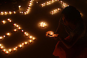 ZHAOTONG, CHINA - AUGUST 04: (CHINA OUT) <br /> <br /> 6.5-magnitude Earthquake Hits Yunnan<br /> <br /> Candlelights gets put on the ground to bless for Ludian earthquake victims on August 4, 2014 in Yangzhou, Jiangsu province of China. A 6.5-magnitude earthquake hit Zhaotong\'s Ludian county at a depth of 12 kilometers. The quake struck Longtoushan Township at 4:30 pm, Beijing time on Sunday, about 50 kilometers from the city center of Zhaotong. About 398 people were killed, 1801 wounded, 3 missing and 1.08 million people affcted in Ludian earthquake.<br /> ©Exclusivepix