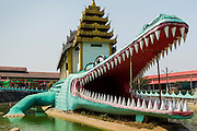 """02 MARCH 2014 - MYAWADDY, KAYIN, MYANMAR (BURMA): The """"Crocodile Temple"""" in Myawaddy, Myanmar, is one of the town's most unique Buddhist temples. Myawaddy is separated from the Thai border town of Mae Sot by the Moei River. Myawaddy is the most important trading point between Myanmar and Thailand.     PHOTO BY JACK KURTZ"""