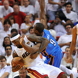 Jun 17, 2012; Miam, FL, USA; Miami Heat small forward LeBron James (6) gets tangled with Oklahoma City Thunder power forward Serge Ibaka (9) during the third quarter in game three in the 2012 NBA Finals at the American Airlines Arena. Mandatory Credit: Derick E. Hingle-US PRESSWIRE