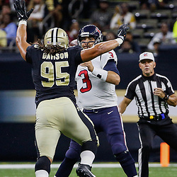 Aug 26, 2017; New Orleans, LA, USA; New Orleans Saints defensive tackle Tyeler Davison (95) pressures Houston Texans quarterback Tom Savage (3) during the second quarter of a preseason game at the Mercedes-Benz Superdome. Mandatory Credit: Derick E. Hingle-USA TODAY Sports
