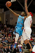 GARLAND, TX - NOVEMBER 11: Xavier Munford #5 of the Rhode Island Rams drives to the basket against Keith Frazier #4 of the SMU Mustangs on November 11, 2013 at the Curtis Culwell Center in Garland, Texas.  (Photo by Cooper Neill/Getty Images) *** Local Caption *** Xavier Munford