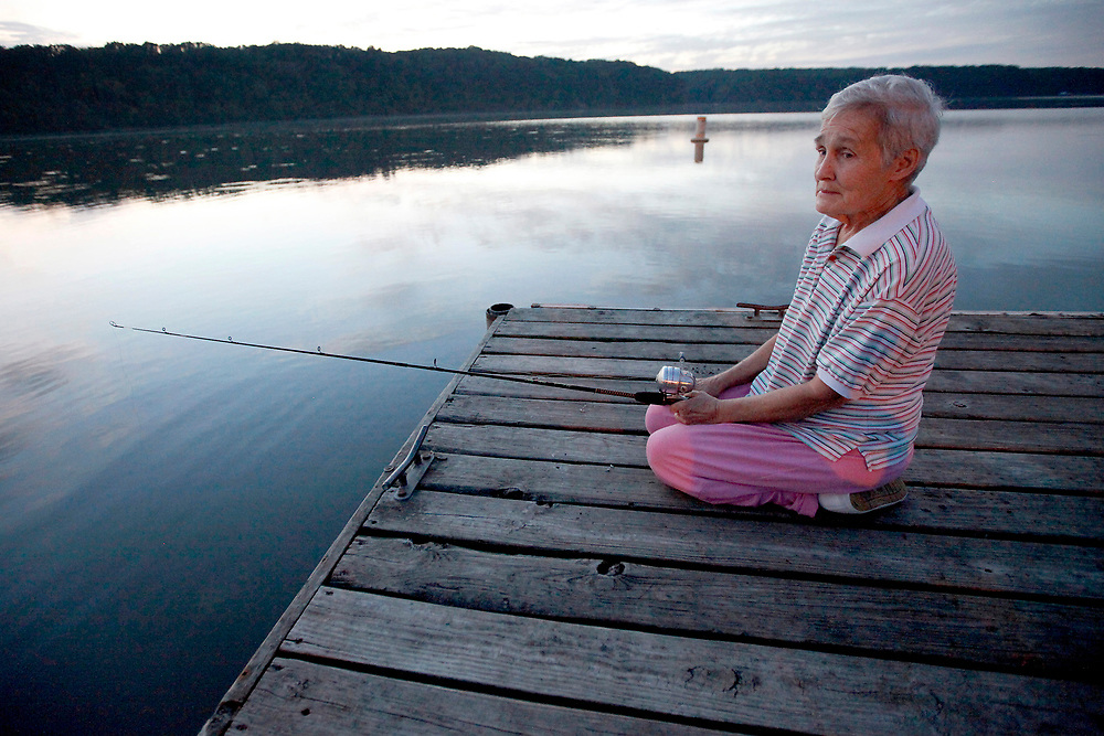 """I hope there are fishing holes in heaven,"" Jeannie Ridgway said as she cast her line out from the end of the dock at Lake Charleston Wednesday. Sept. 22, 2010, in Charleston, Ill. Ridgway, of Newcomerstown, Ohio, who was in town for her daughter's wedding later in the week, said she fishes whenever she can and enjoys it even when she isn't catching anything. (Herald & Review/ Stephen Haas)"