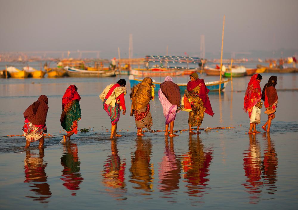 Pilgrims bathing in Ganges, during Maha Kumbh Mela festival, world's largest congregation of religious pilgrims. Allahabad, India.
