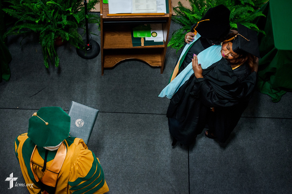 Graduates arrive on stage during the 92nd and final Commencement Exercises on Saturday, April 28, 2018, in the Julius and Mary Jenkins Center at Concordia College Alabama in Selma, Ala. LCMS Communications/Erik M. Lunsford