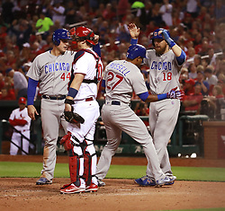 September 27, 2017 - St. Louis, MO, USA - The Chicago Cubs' Addison Russell (27) celebrates at home after his three-run home run against the St. Louis Cardinals during the seventh inning at Busch Stadium in St. Louis on Wednesday, Sept., 27, 2017. (Credit Image: © Nuccio Dinuzzo/TNS via ZUMA Wire)