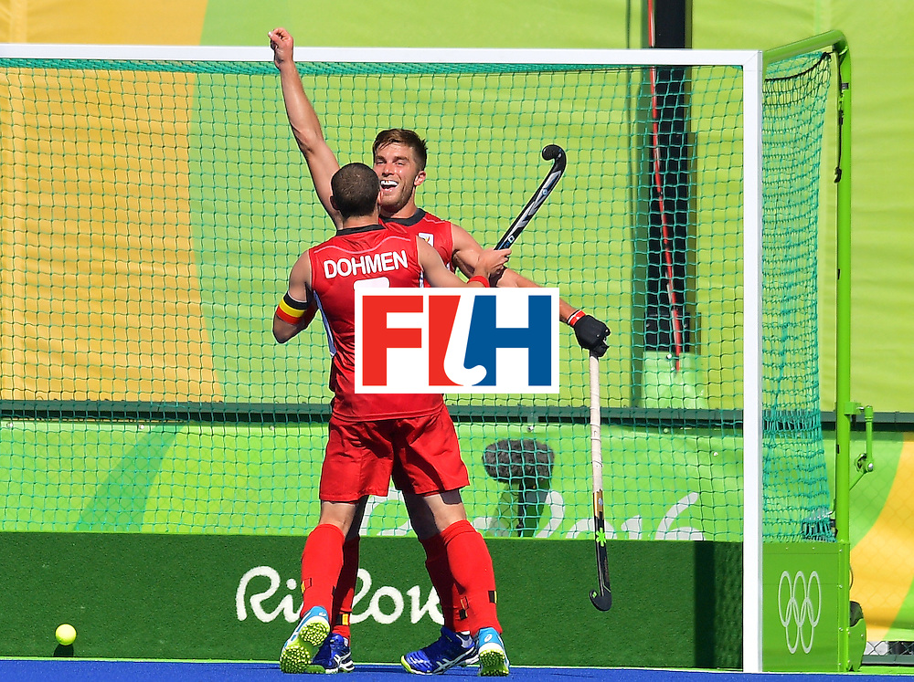 Belgium's Cedric Charlier (R) celebrates scoring a goal with Belgium's John John Dohmen during the men's field hockey Belgium vs Britain match of the Rio 2016 Olympics Games at the Olympic Hockey Centre in Rio de Janeiro on August, 6 2016. / AFP / Carl DE SOUZA        (Photo credit should read CARL DE SOUZA/AFP/Getty Images)