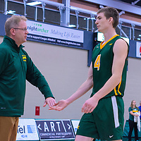 Head Coach, Greg Barthel, talks to 2nd year middle Cody Caldwell (4) of the Regina Cougars during the Men's Volleyball Home Game vs Trinity Western  on October 28 at the CKHS University of Regina. Credit Matt Johnson/Arthur Images